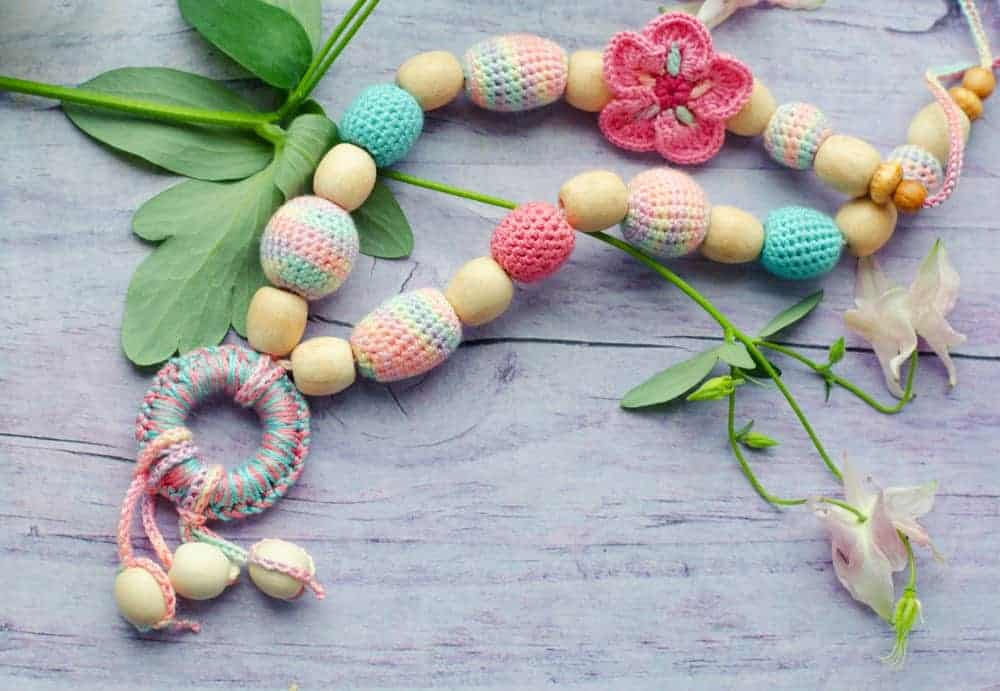 A knitted yarn necklace with beads..