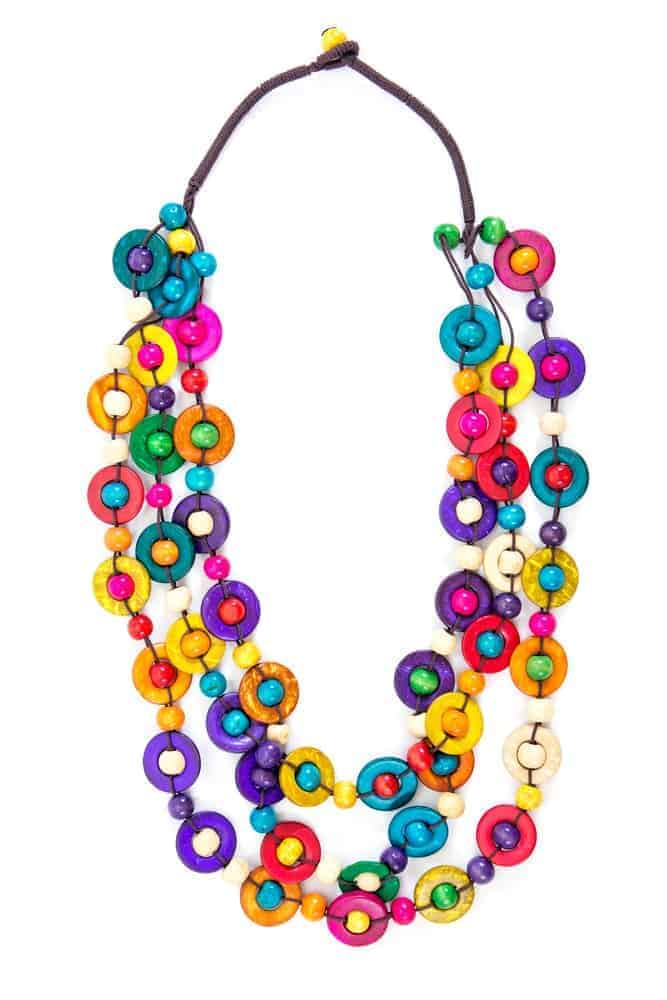 A close look at a multi-colored string necklace.
