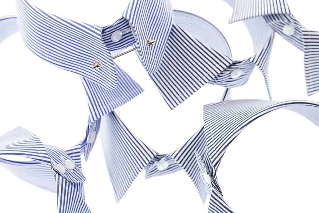A variety of collars on a white surface.