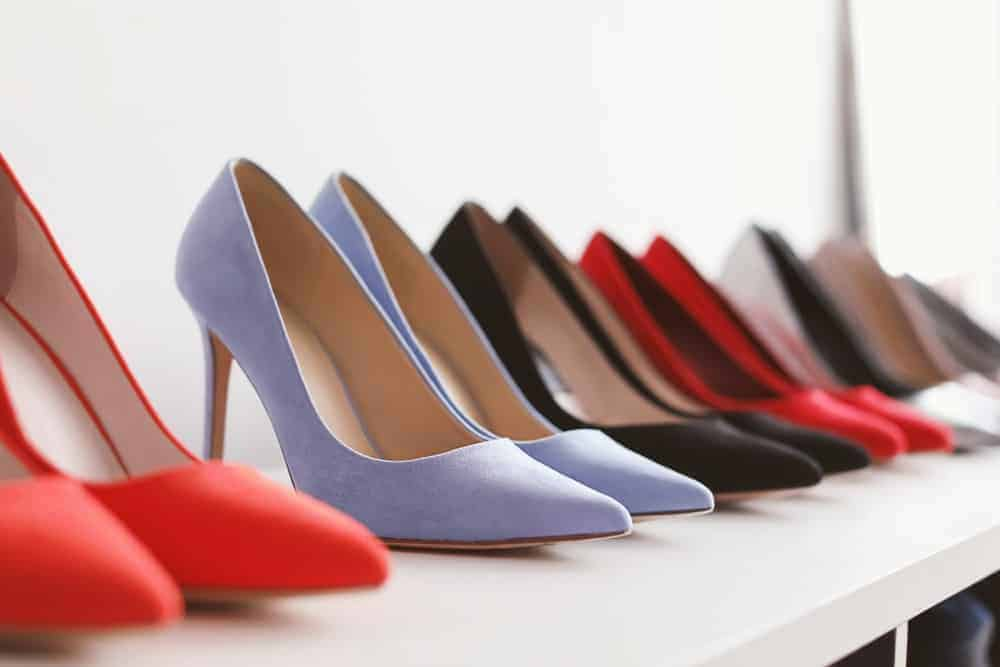 A row of women's high heel shoes on display.