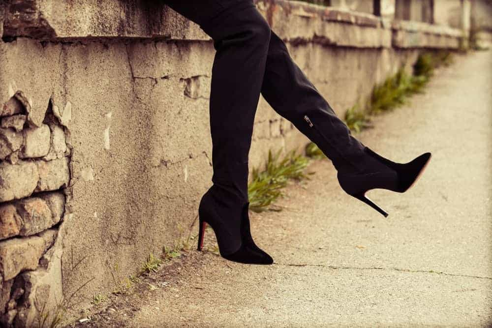 A close look at a woman wearing High Heel Boots.