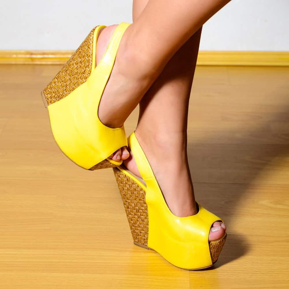 A pair of yellow Platform Heels.