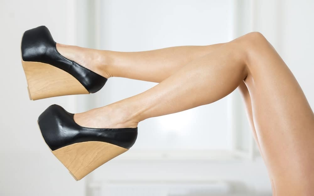 A close look at a woman wearing a pair of Wedge Heels.
