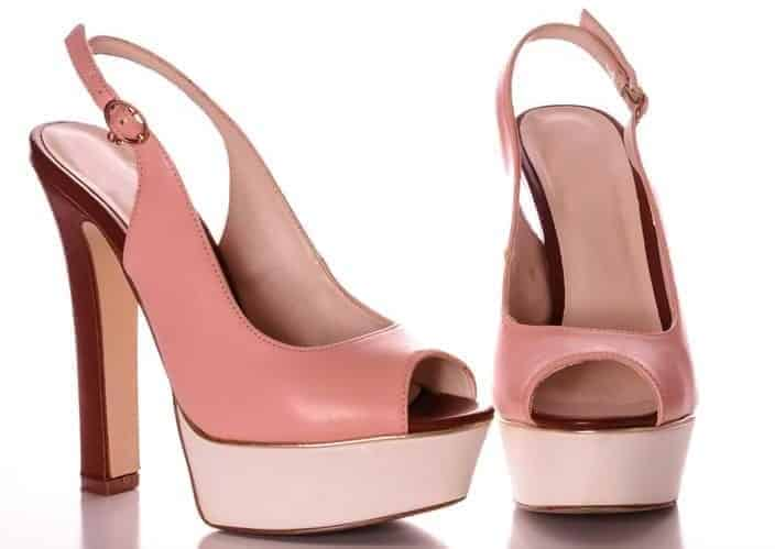 A pair of pink leather ankle strap heels.
