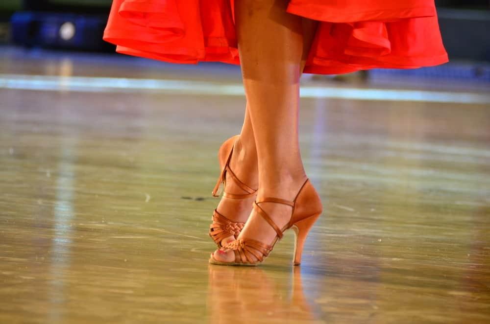 A close look at a woman wearing ballroom dance heels.