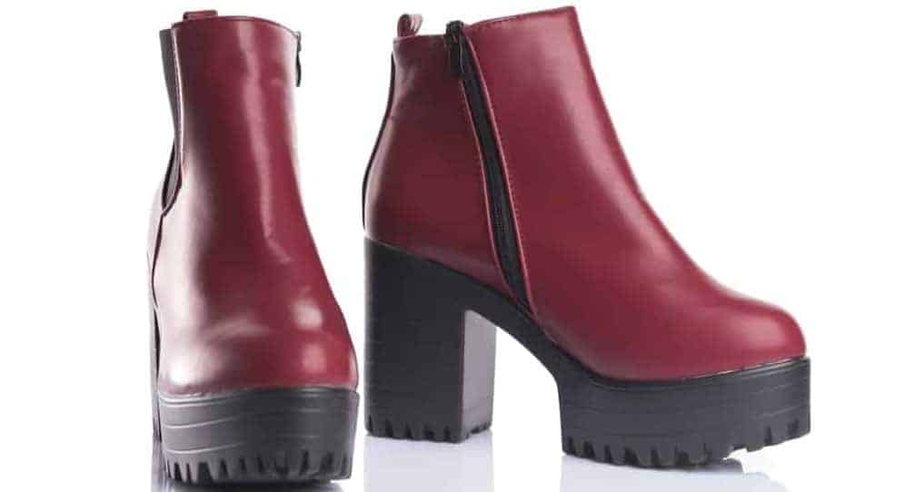 A pair of red leather boots with chunky heels.