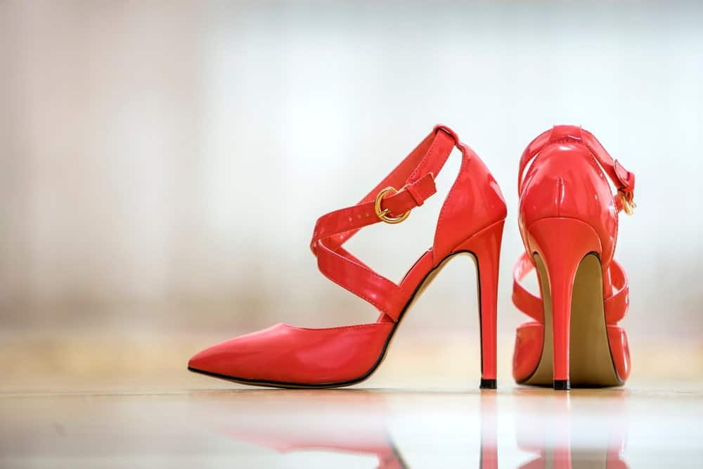 A pair of shoes with cut out Heels.