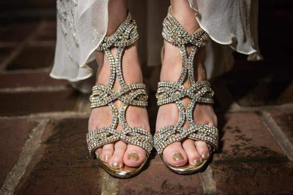 A close look at a woman wearing a pair of Gold-studded High Heels.