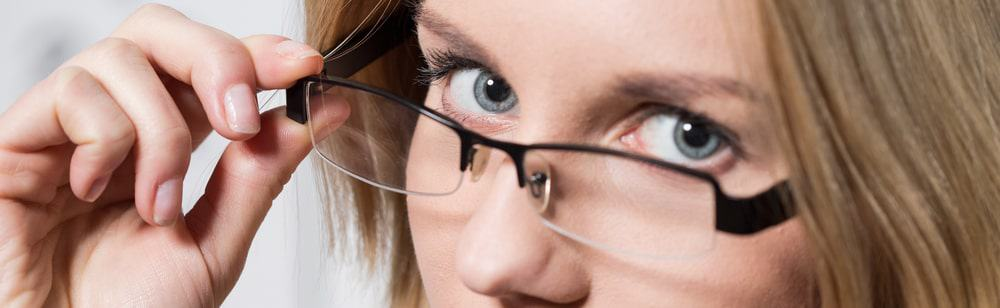 Close-up of a woman wearing designed spectacles.