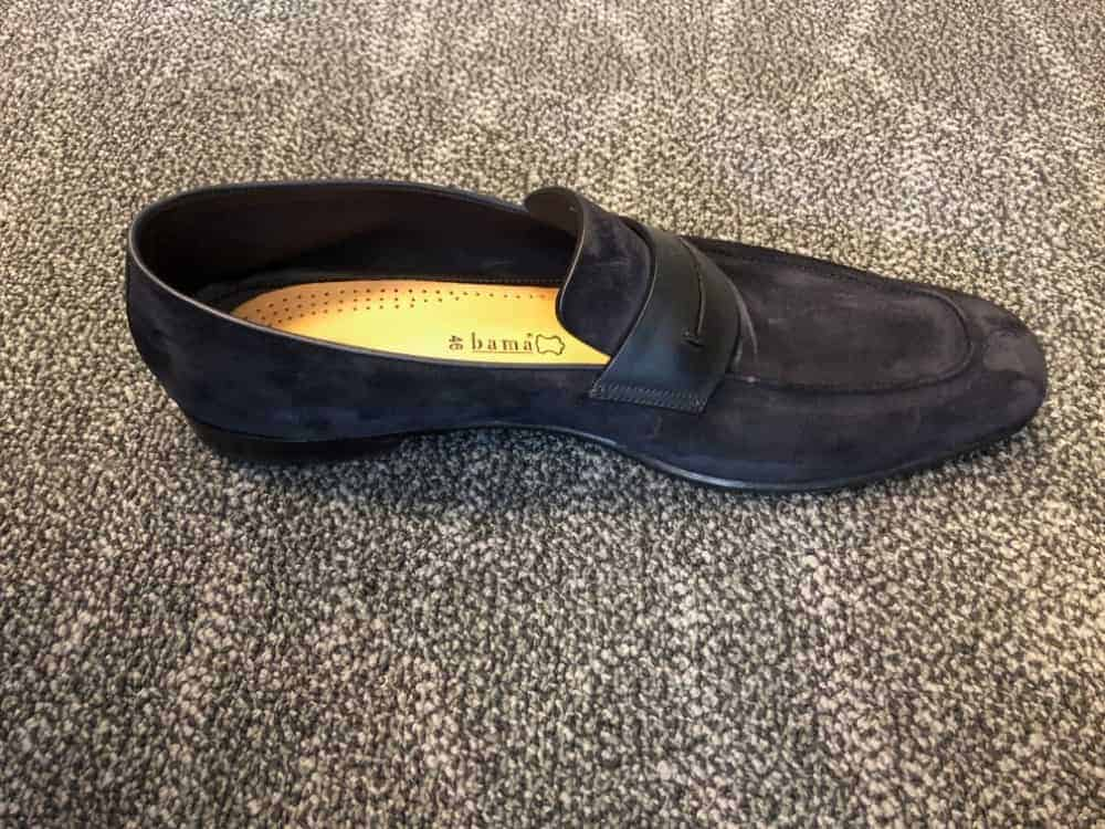 Side view of blue Zegna suede loafer.