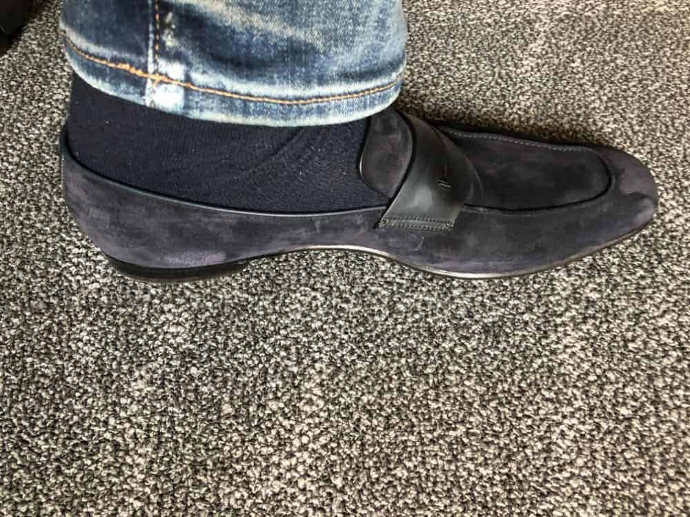 Inside view of blue Zegna suede loafer with jeans on.