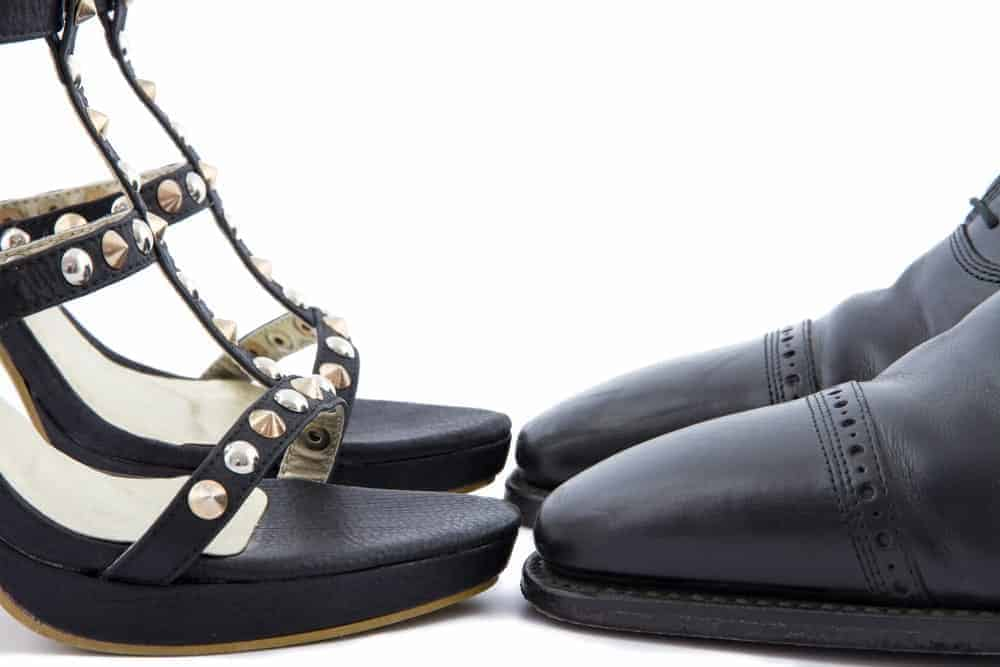 Pair of black men's and women's dress shoes