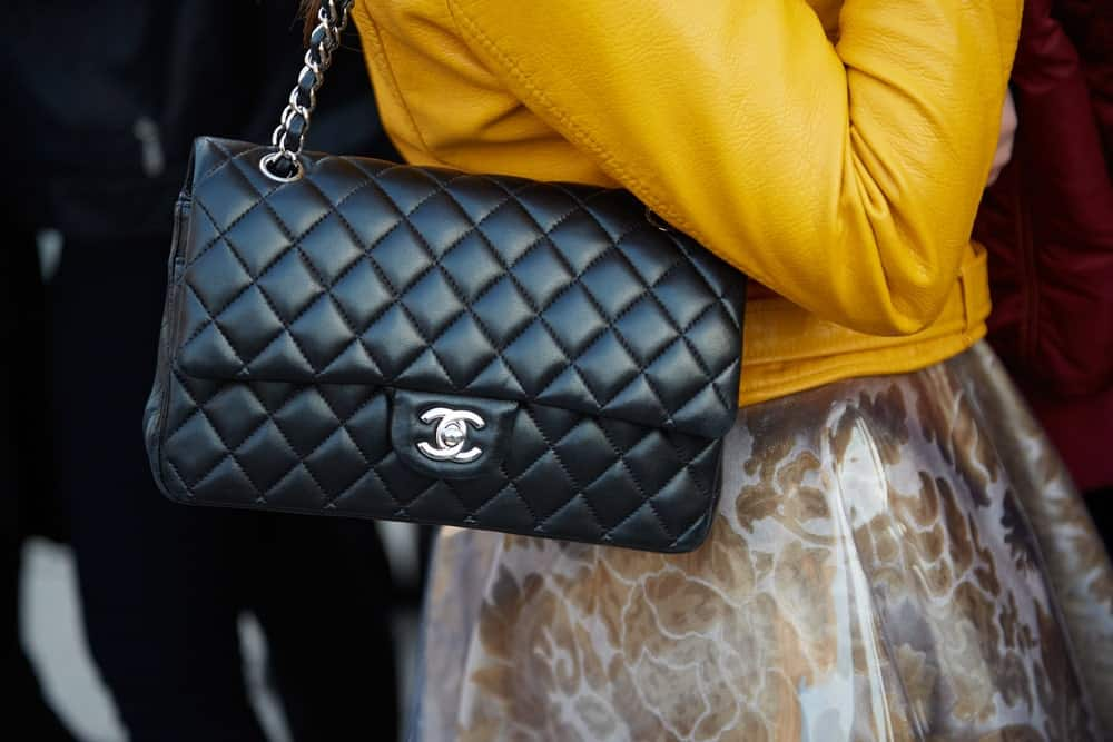 Woman with black leather Chanel bag.
