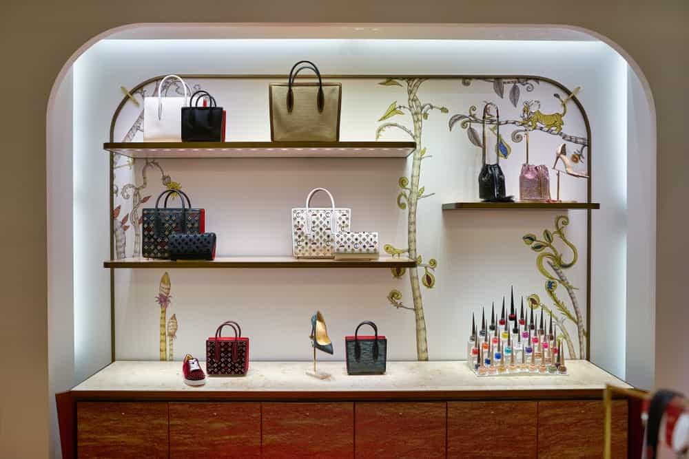 Christian Louboutin bags on display.