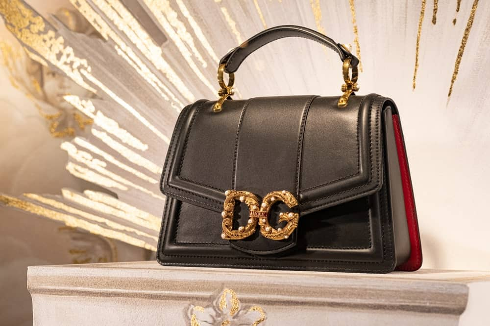 Women's black leather Dolce & Gabbana handbag displayed on a store in Moscow.