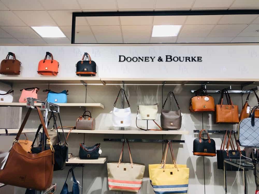 Display of Dooney and Bourke handbags and purses.
