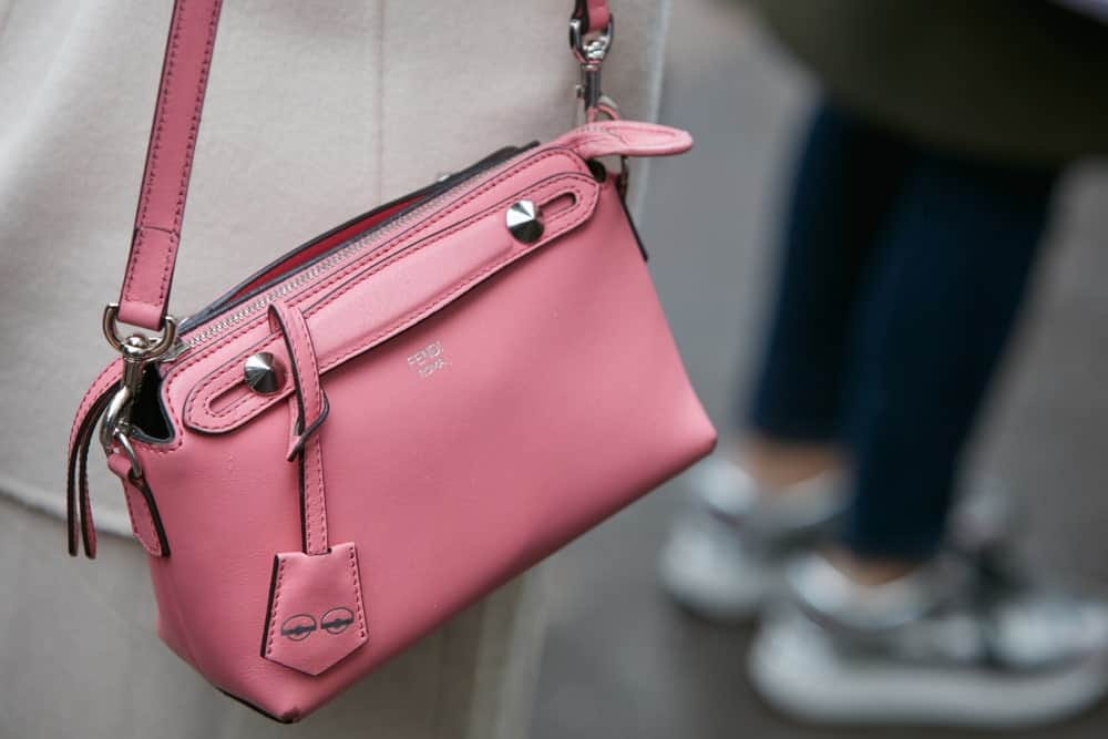 Woman with pink leather Fendi bag.