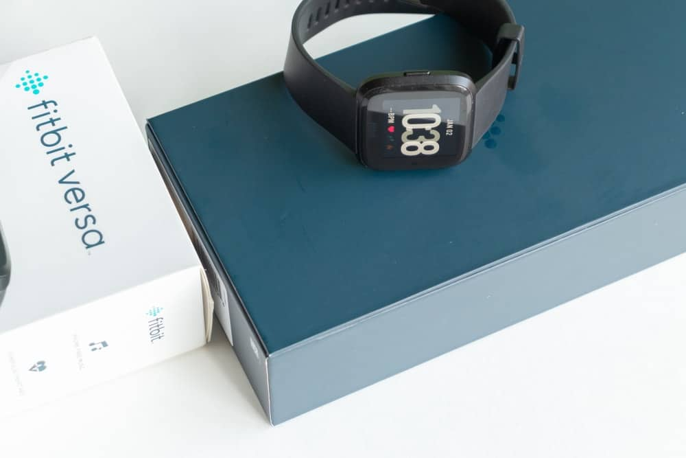 A brand new Fitbit Versa on its box.