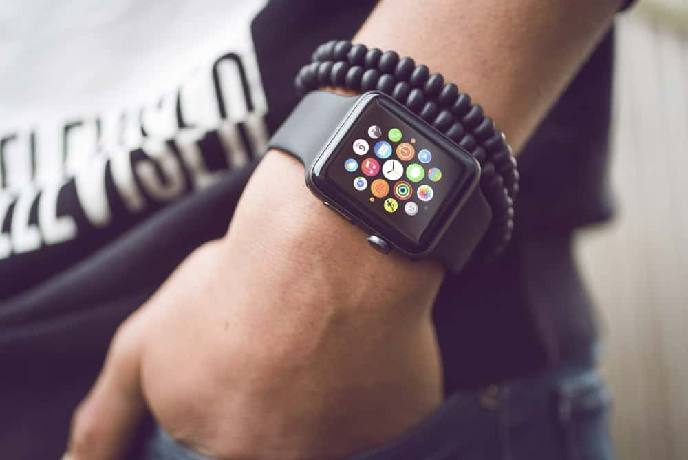 A close look at a man wearing a smartwatch.