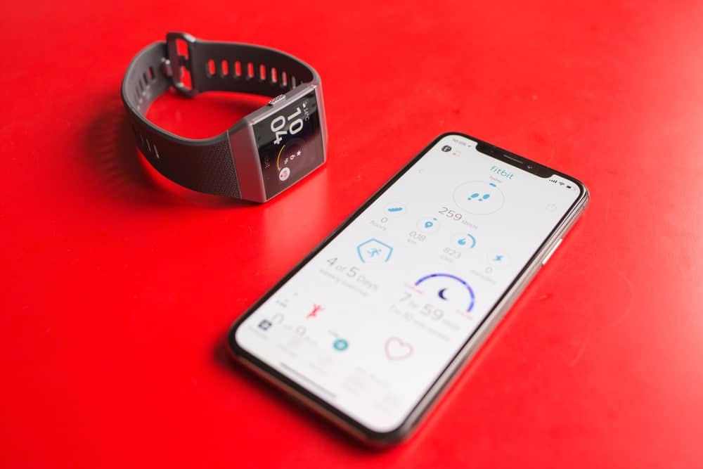 iPhone X and a Fitbit ionic smartwatch connected wireless via Fitbit app.