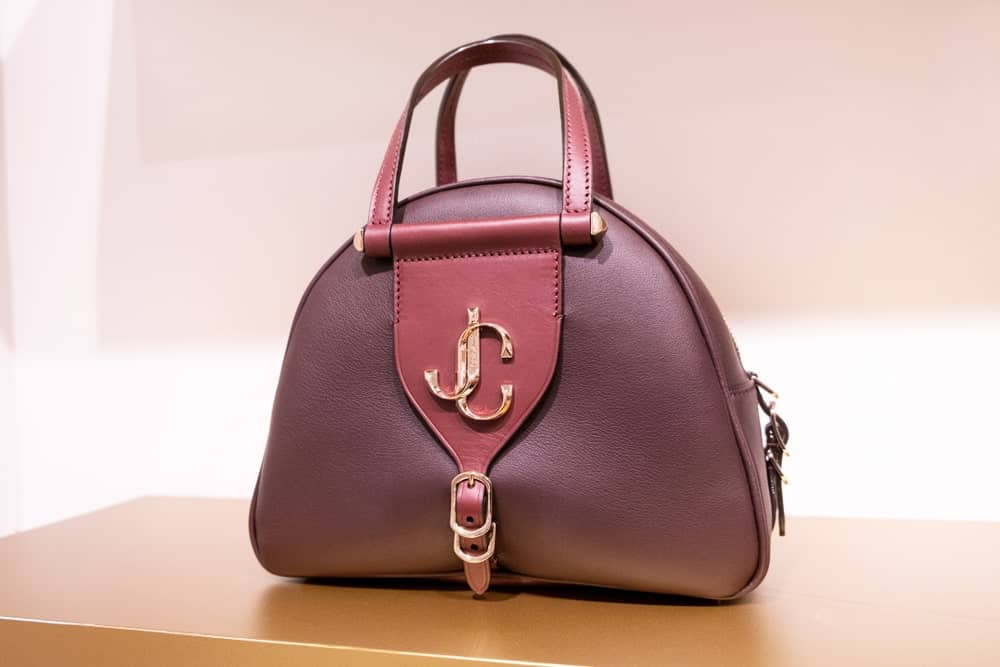 Jimmy Choo maroon handbag on display.