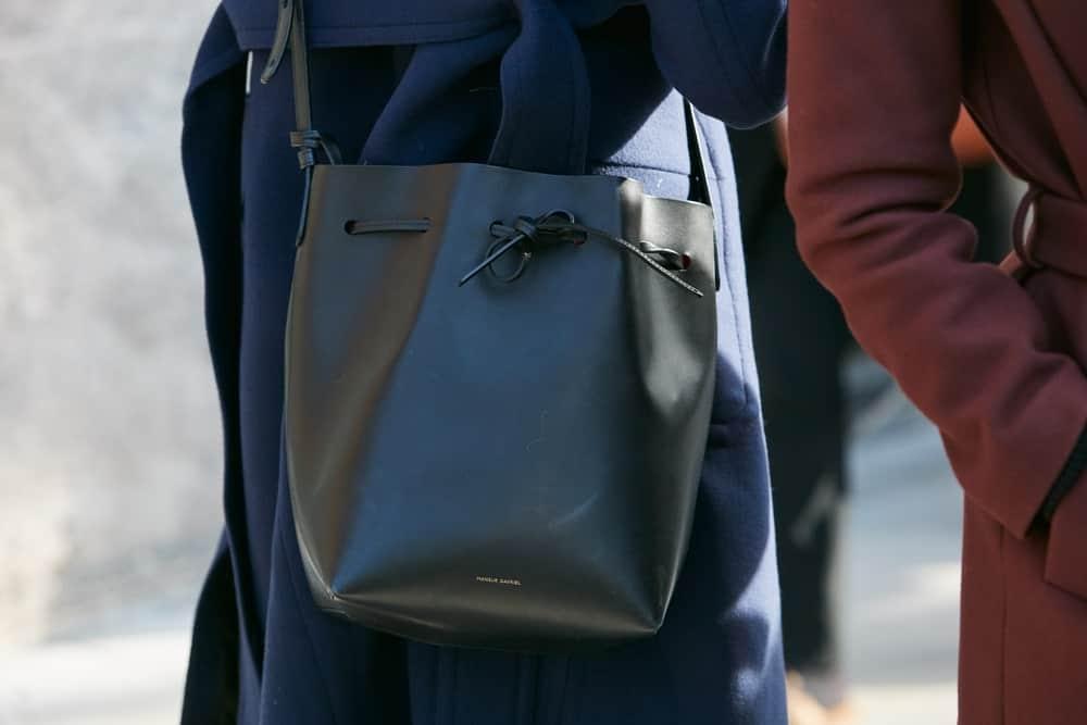 Woman with black Mansur Gavriel leather bag