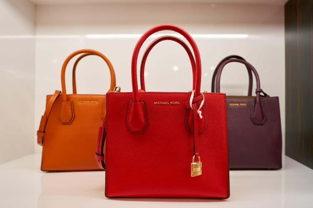 Michael Kors bags on display.