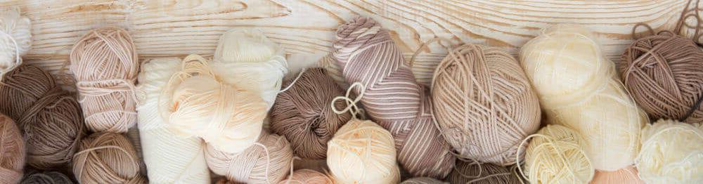 A variety of yarns in brown and neutral tones.