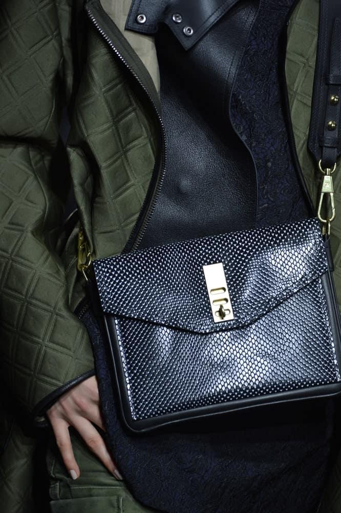 Model with Phillip Lim satchel bag.