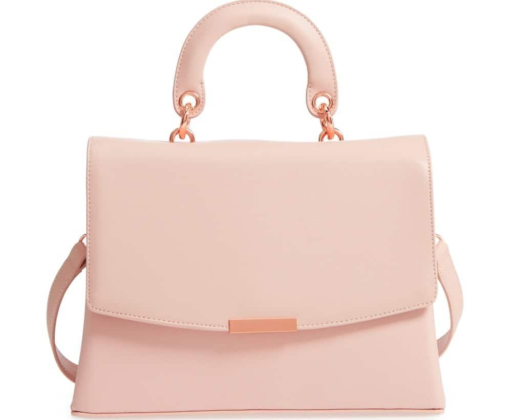 A pink leather satchel purse.