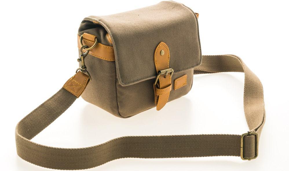 A close look at a green linen Messenger bag.