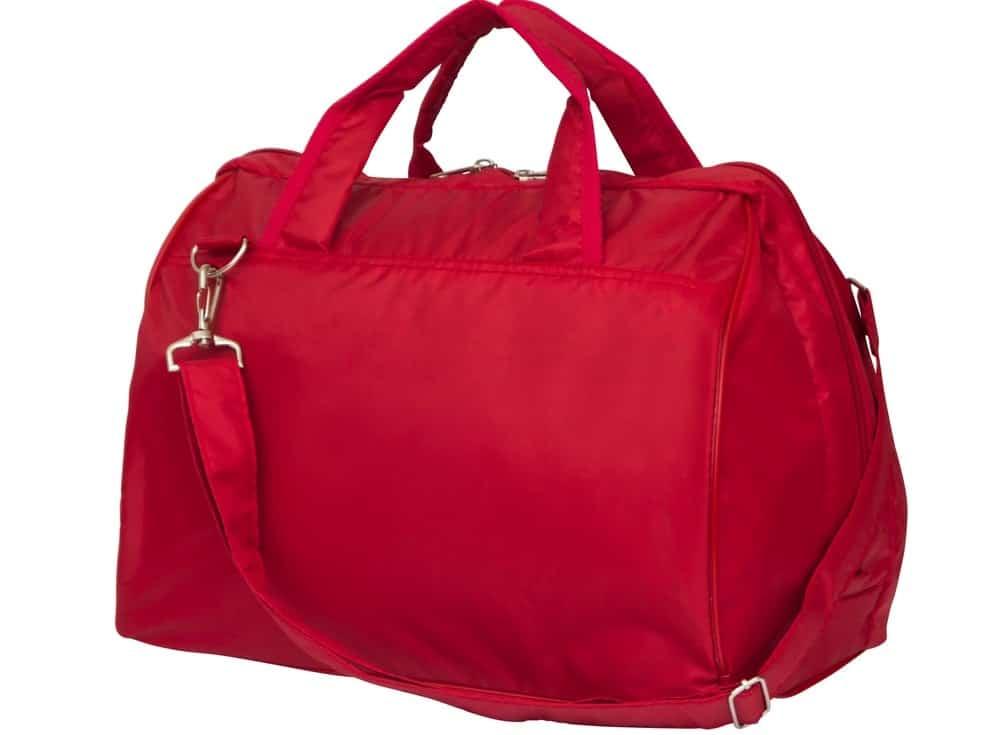 A close look at a red duffel bag.