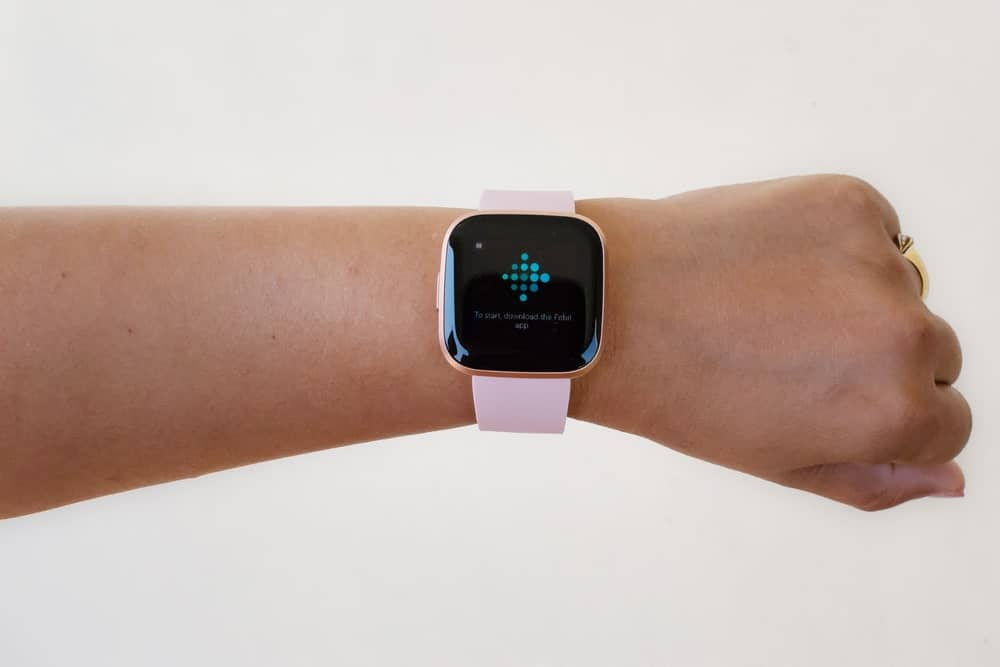 Woman hand wearing a smartwatch.