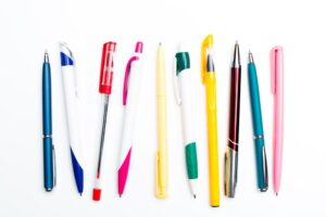 Various types of pens on a white background