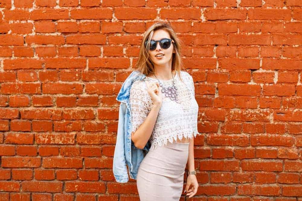 A woman wearing a white lace blouse.