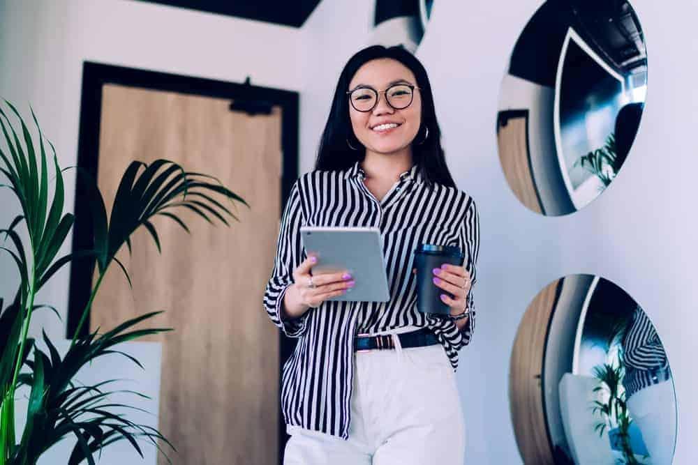 A woman wearing a striped U-neck blouse.