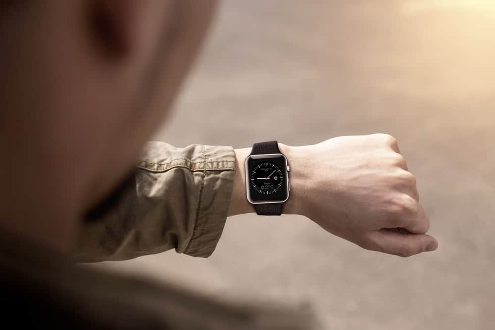 A close look at a man checking his smartwatch.
