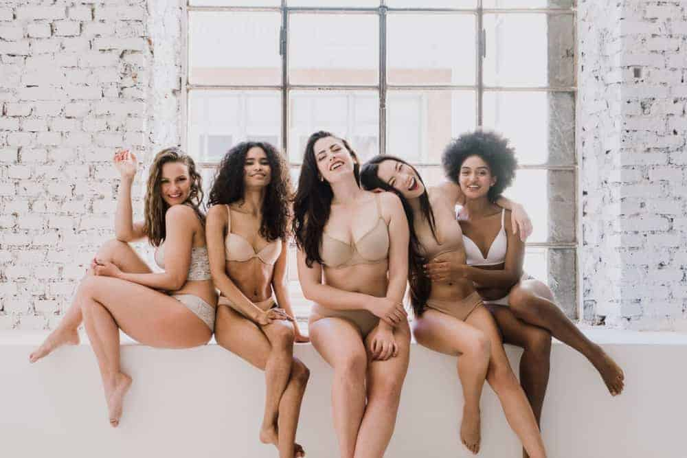 A group of five women wearing lingerie.
