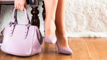 A close look at a woman wearing a pair of shoes that matches her bag.