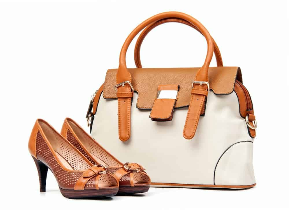 A pair of leather high-heeled shoes that matches the handbag.