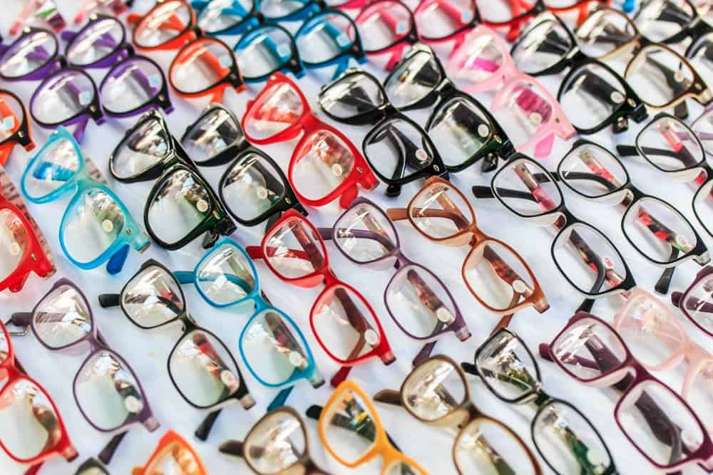 Various colorful glasses on display at a shop.
