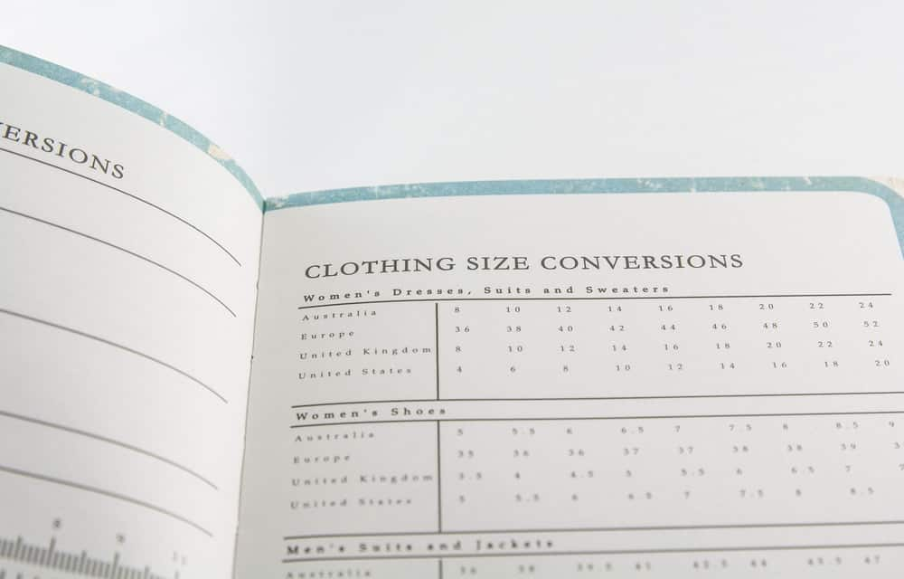A close look at a page of a book showing clothing size conversions.