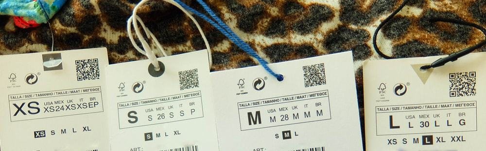 A look at sets of clothes tag labels depicting sizes.