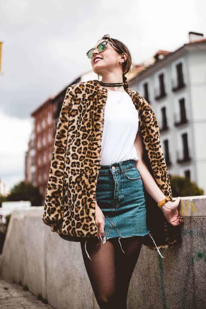 A woman wearing a bold animal print jacket.