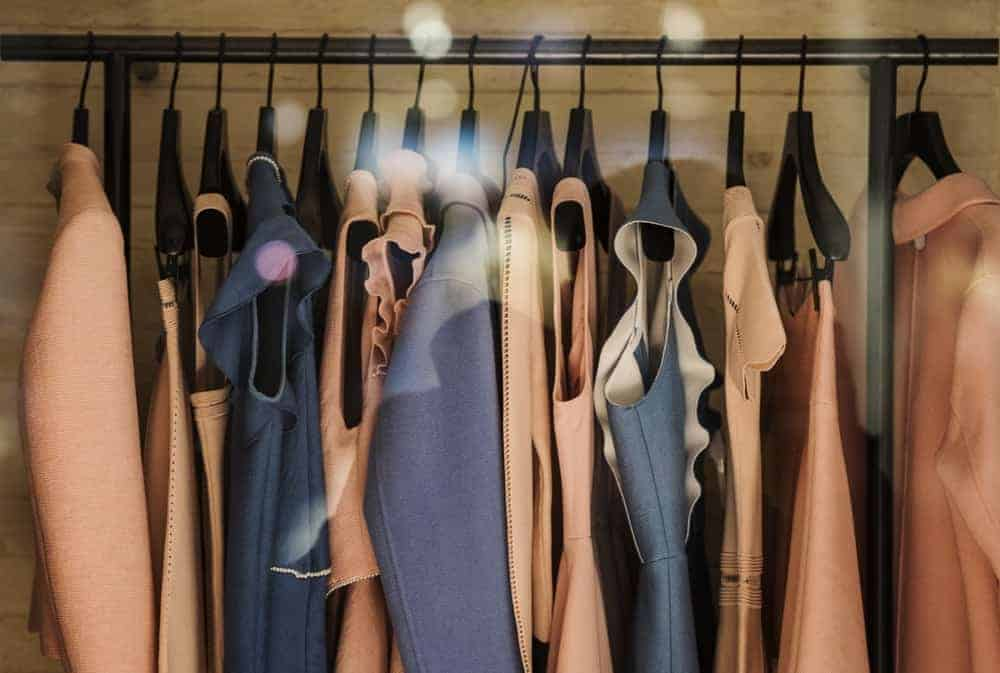 A close look at a rack of clothes in a boutique shop.