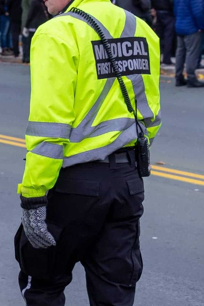 A close look at a male medical first responder wearing dark cargo pants.