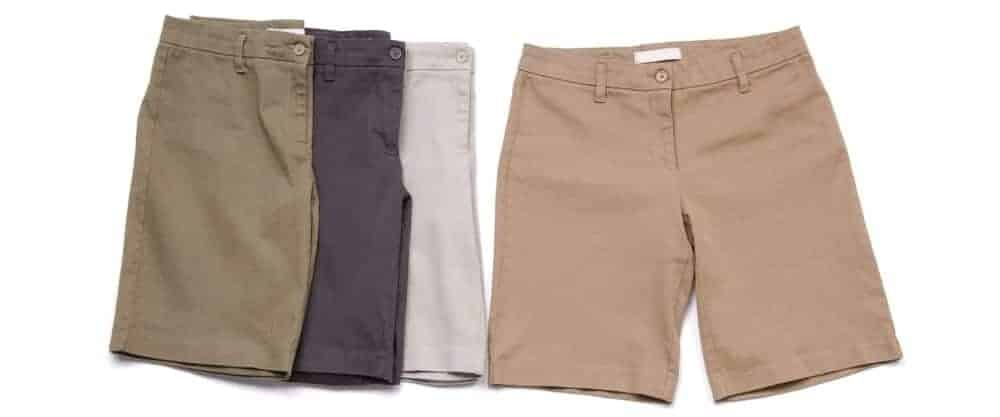 Four men's shorts on a white surface.
