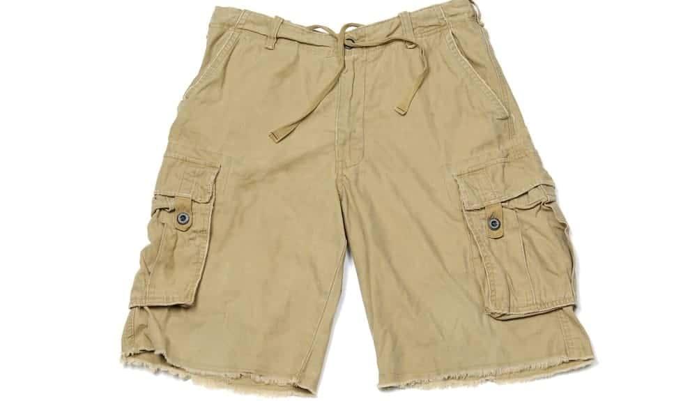 A close look at a pair of khaki cargo shorts.