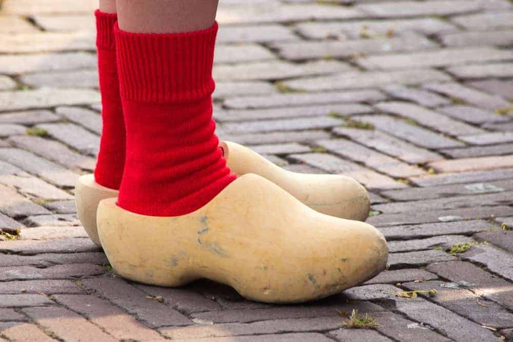 This is a close look at a woman wearing a pair of Dutch wooden clogs.