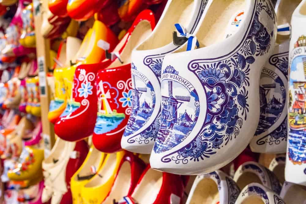 Various colorful Dutch clogs on display at a store.